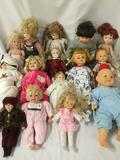 Fifteen vinyl and porcelain dolls from makers like Cititoy, Kingstate, Alexander Doll Co., Heritage