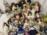 Thirty vinyl and porcelain dolls from makers like Seymour Mann, Geppeddo, DanDee, Dolls of Days Gone