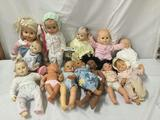 13x vinyl dolls. Berjusa and mor. Largest doll measures approximately 22x11x6 inches.
