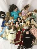 Twenty-three porcelain, vinyl, and ceramic dolls from makers like Mariah Osmond, Seymour Mann, FCM,