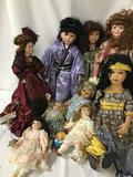 Ten porcelain and vinyl dolls from makers like Seymour Mann, Classical Treasures, and others.