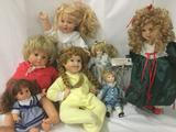 Seven vinyl, composite and porcelain dolls from makers like Gotz, Showstoppers, and more. JRL