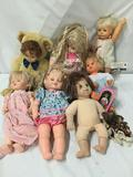 9x vinyl and porcelain dolls. Cititoy, baby so real, and more. Largest doll measures approximately