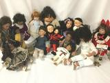 Fourteen porcelain, composite, and vinyl dolls from around the world. Crafted by makers like Danbury