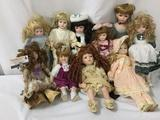Ten porcelain dolls from makers like House of Lloyd, PCI, Heritage Mint, and others. Largest doll
