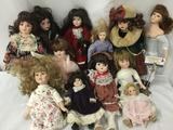 Twelve porcelain and ceramic dolls from makers like Heritage Mint. Largest doll is approximately