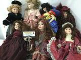 Seven porcelain dolls from makers like Russ, Franklin Heirloom, and others. Largest doll is