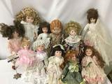Eleven porcelain dolls from makers like Daisy Kingdom, YLM, and others. Largest doll is