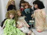 Six big porcelain dolls from makers like Three Heart, Traditions, and others. Largest doll is