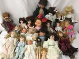 Over twenty porcelain, vinyl, and composite dolls from makers like Geppeddo, Lauer Toys, Pangea