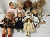 Nine soft vinyl and porcelain dolls from makers like Famosa, Zapf, and Bradley Dolls. Largest doll