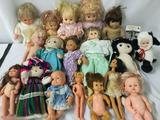 Eighteen vinyl, composite, and cloth dolls from makers like Disney, Playmates, Geppeddo, and others.