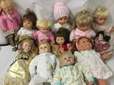 Twelve vinyl, composite, and porcelain dolls from makers like Battat, Pat Secrest, Heritage Mint,