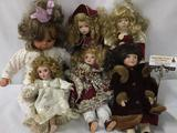 Six porcelain and composite dolls from makers like Danbury Mint. Largest doll measures approximately