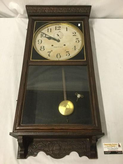 Antique Thirty Day wall clock by Waterbury Clock Co - shows some wear as is