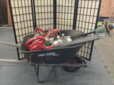 Wheelbarrow full of power tools incl. Craftsman leaf blower, 1 Milwaukee heavy duty skill saw etc