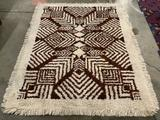 Decorative handmade shag rug with geometric neutral tone design - as is needs cleaning