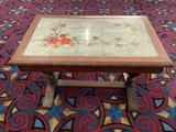 Small carved oak side table with painted flower tile design top - signed RL