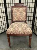 Vintage mahogany dining room chair with flower upholstery and east-lake design