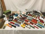 Box of S scale model trains, transformers, models, carriages, locomotives, track, misc tools and