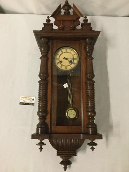 Antique German RA time strike wall clock with mahogany case, steeple topper and pendulum