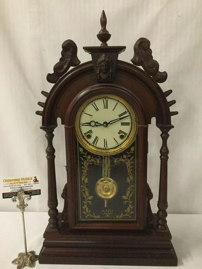 Antique time strike mantle clock with unique molding, floral design glass front & has pendulum/key