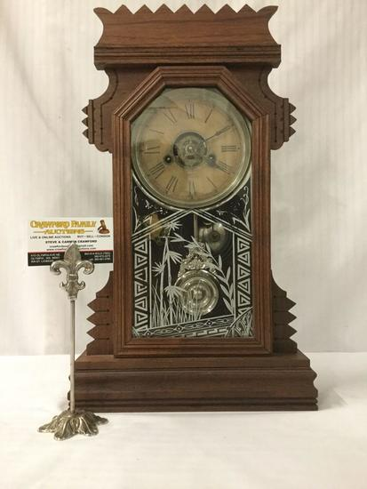 Antique Ansonia mantle clock w/ key & pendulum, late mission era carving and glass front