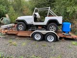 2003 Tandem wheel flat bed trailer with project jeep. Jeep has abandoned title