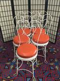5 vintage iron cafe chairs from Puyallup Fair Restaurant w/ orange vinyl seats and heart backs
