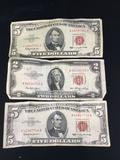 Collection of 3 Red Seal American bills. A pair of 1963 $5 bills and a 1953 $2 bill