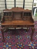 Modern antique reproduction ornate desk with claw feet, deco appearance & nice detail