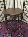Vintage hexagonal side table with carved legs and side detail