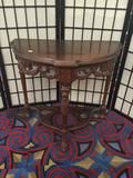 Antique half moon table with a hand carved base & legs feat. a claw foot & lion design