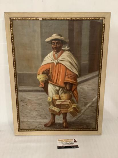 Framed antique canvas painting of a man with baskets, approximately 16 x 21 inches