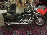 Black 2001 Honda Shadow Sabre 1099 CC cruiser VT1100C2 motorcycle with clean title & 17550 miles