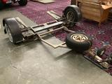 Vehicle tow trailer with good tires, spare tire, wheel straps, brake lights and mud flaps