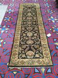 Agra wool runner rug from India w/ classic black and gold color geometric floral design