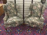 Pair of vintage wingback arm chairs with dark floral upholstery