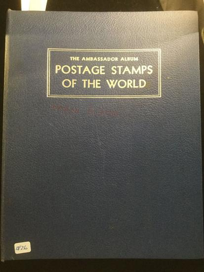 The Ambassador international Postage stamp album w/ hundreds of stamps, see pics
