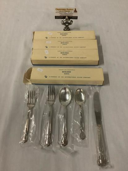 4 place settings of Rogers silver plate flatware in original boxes