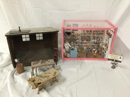 Miniature toy store window box display with doll figures plus doll sized workshop w/ tools