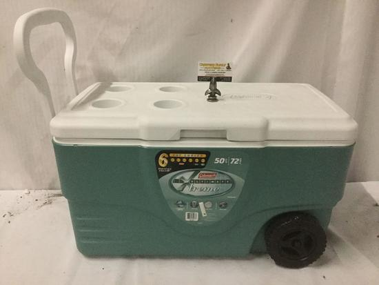 Coleman Unltimate Xtreme 50 qt cooler with four cup holders, wheels, drain, and 72 cans of beer