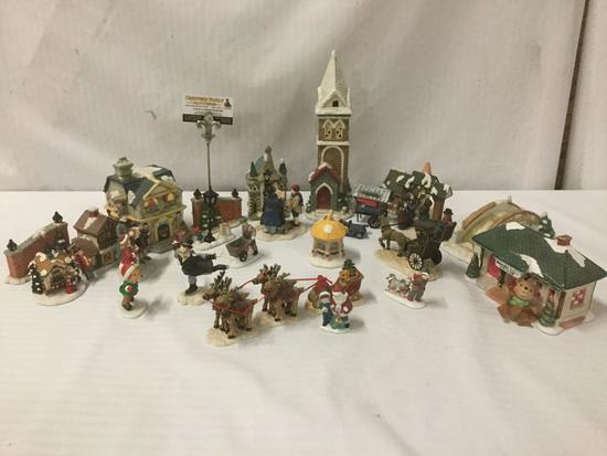 Over 25 porcelain and ceramic Christmas miniatures/ornaments. Approx. 15x11x8 inches.