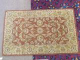 Brown Indian handmade wool rug with earthen hues and floral designs from the India House Collection