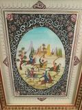Elaborately framed painted art piece (Middle East) depicting a hunting/riding scene - unsigned