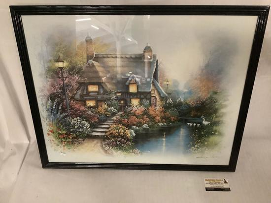 Framed print of cottage with flowers and swans in pond by Andres (?) approx 29.5 x 24 inches
