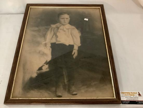 Antique framed portrait of young boy approximately 18 x 22 inches