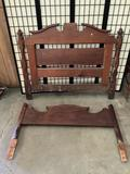 Antique wood bed frame, does not include side rails, approx 57x49 inches.