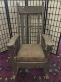 Antique wooden oversized rocking chair with some age wear - see pics