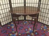 Ethan Allen dark wood side table w/cabriole legs, approx. 28x24x23 inches.